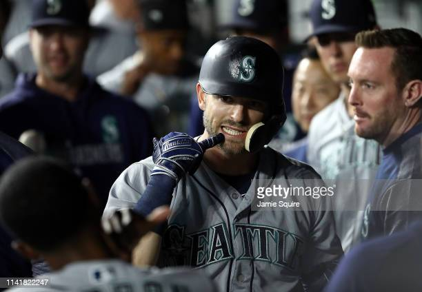 Ryon Healy of the Seattle Mariners is congratulated by teammates in the dugout after hitting a solo home run during the 9th inning of the game...