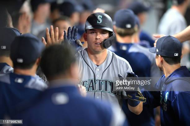 Ryon Healy of the Seattle Mariners is congratulated for his second home run of the night against the Los Angeles Angels of Anaheim in the sixth...