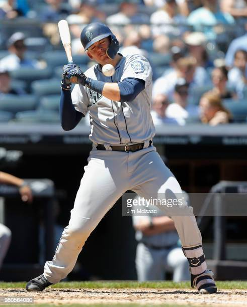 Ryon Healy of the Seattle Mariners is hit by a pitch in the fourth inning against the New York Yankees at Yankee Stadium on June 21, 2018 in the...