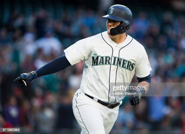 Ryon Healy of the Seattle Mariners points to the dugout after hitting a two run home run against Andrew Heaney of the Los Angeles Angels of Anaheim...