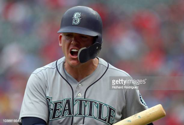 Ryon Healy of the Seattle Mariners reacts after striking out in the eighth inning against the Texas Rangers at Globe Life Park in Arlington on...