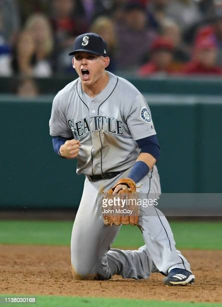 Ryon Healy of the Seattle Mariners reacts to throwing out David Fletcher of the Los Angeles Angels of Anaheim for the final out of the game at Angel...