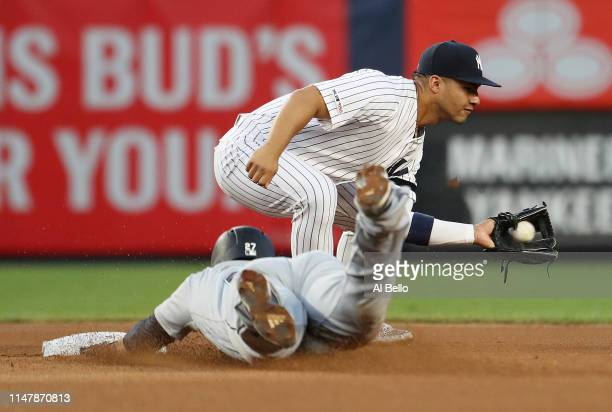 Ryon Healy of the Seattle Mariners steals second base against Gleyber Torres of the New York Yankees during their game at Yankee Stadium on May 08...