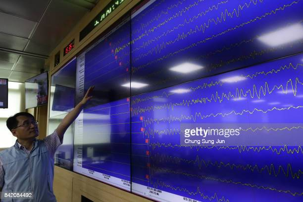 Ryoo YongGyu a Monotoring director of the National Earthquake and Volcano Center shows seismic waves taking place in North Korea on a screen at the...