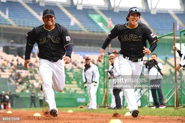 Ryosuke Hirata and Tetsuto Yamada of Japan in action during SAMURAI JAPAN's training camp at the Sun Marine Stadium Miyazaki on February 26 2017 in...