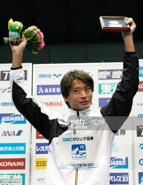 Ryosuke Irie celebrates on the podium after winning the Men's 200m Backstroke during day six of the Japan Swim 2012 at Tokyo Tatsumi International...