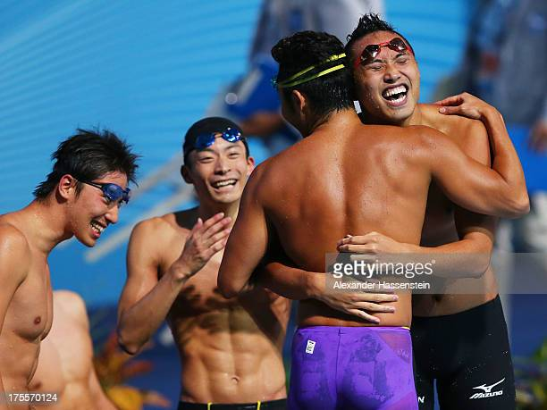 Ryosuke Irie Kosuke Kitajima Takuro Fujii and Shinri Shioura of Japan celebrate after the USA are disqualified and they are instated as bronze medal...