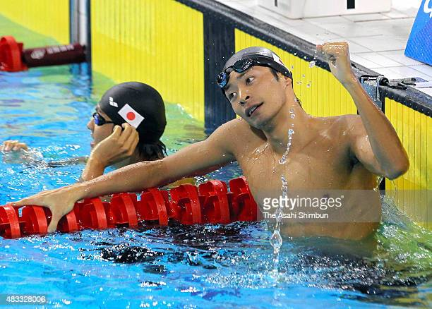 Ryosuke Irie of Japan celebrates winning the gold in the Swimming Men's 100m Backstroke final during day four of the Guangzhou Asian Games at...