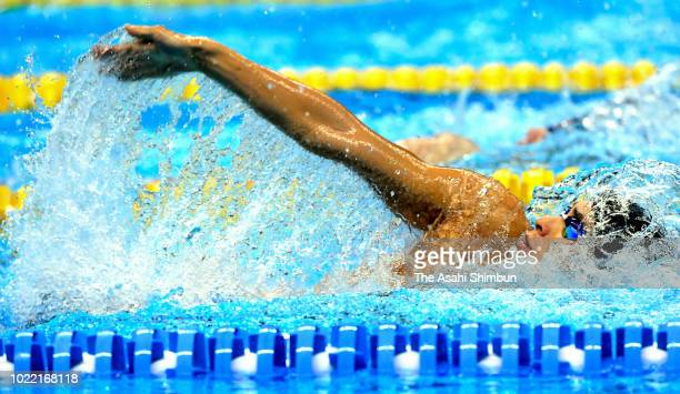 Ryosuke Irie of Japan competes in the Swimming Men's 200m Backstroke final at the GBK Aquatics Center on day five of the Asian Games on August 23,...