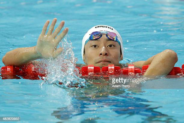 Ryosuke Irie of Japan waves after competing in the Men's 100m Backstroke Heats on day ten of the 16th FINA World Championships at the Kazan Arena on...