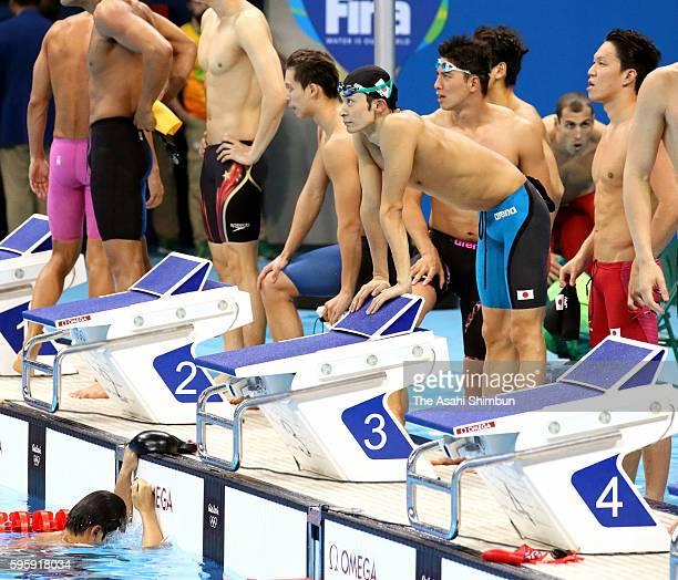 Ryosuke Irie Yasuhiro Koseki Takukro Fujii and Katsumi Nakamura of Japan react after competing in the Men's 4x100m Medley Relay Final on Day 8 of the...