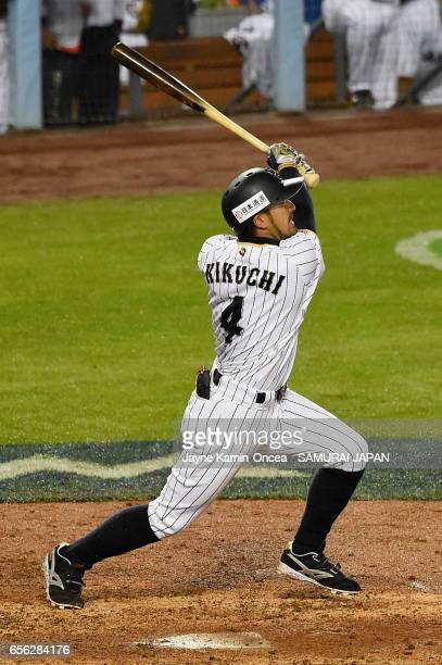 Ryosuke Kikuchi of team Japan hits a gametying home run in the sixth inning against team United States during Game 2 of the Championship Round of the...