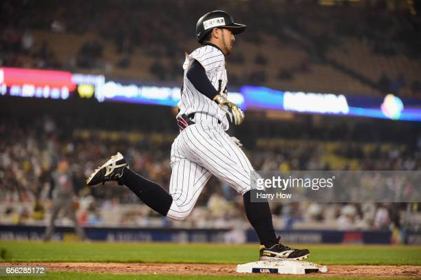 Ryosuke Kikuchi of team Japan rounds the bases after a gametying home run in the sixth inning against team United States during Game 2 of the...