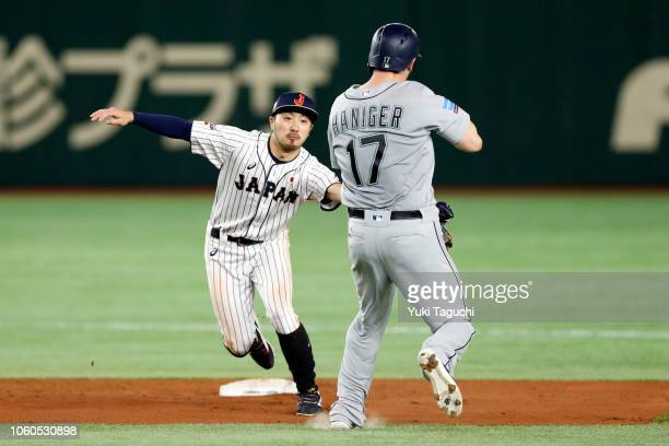 Ryosuke Kikuchi of Team Japan tags out Mitch Haniger of the Seattle Mariners during the Japan AllStar Series game at the Tokyo Dome on Sunday...