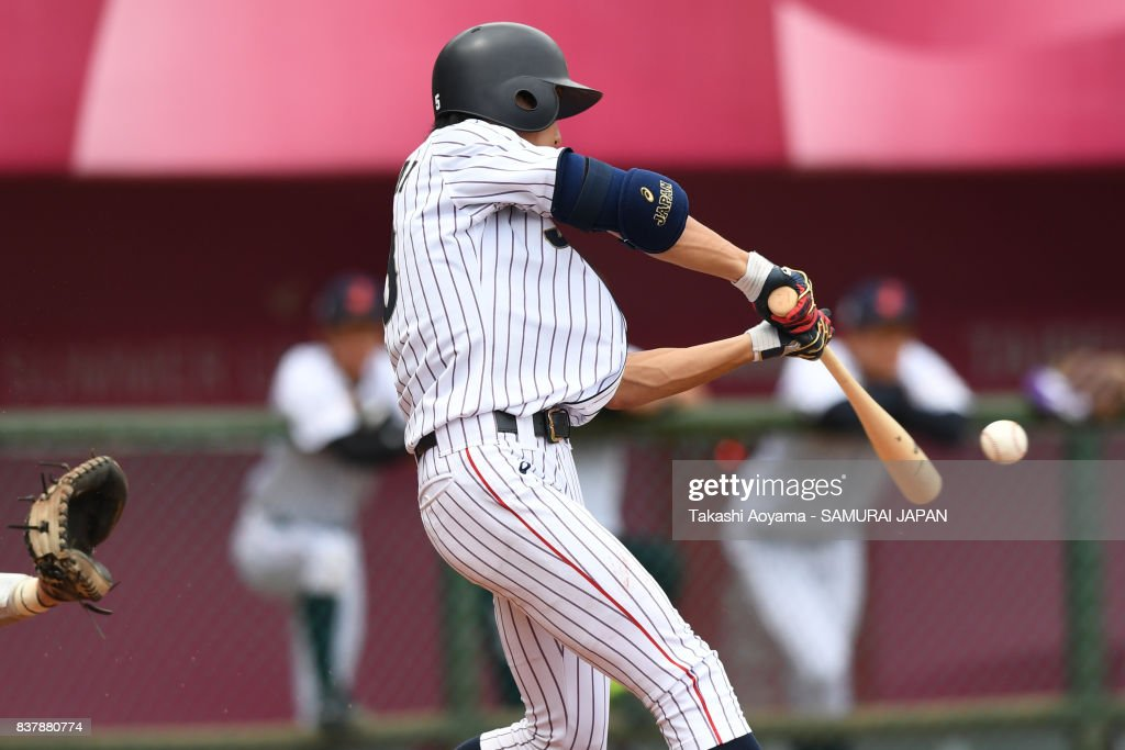 Ryosuke Tatsumi #23 of Japan hits an RBI single in the fifth inning against United States during the Baseball Group B match between Japan and United States during the Universiade Taipei at Xinzhuang Baseball Stadium on August 23, 2017 in Taipei, Taiwan.
