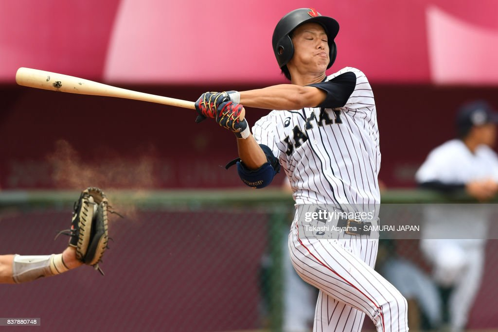 Ryosuke Tatsumi #23 of Japan swings and misses as he bats in the fifth inning against United States during the Baseball Group B match between Japan and United States during the Universiade Taipei at Xinzhuang Baseball Stadium on August 23, 2017 in Taipei, Taiwan.