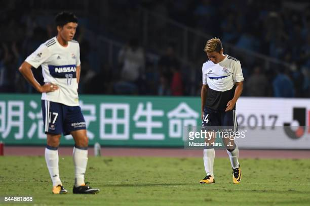 Ryosuke Yamanaka and Cayman Togashi of Yokohama F.Marinos show dejection after their 0-3 defeat in the J.League J1 match between Kawasaki Frontale...