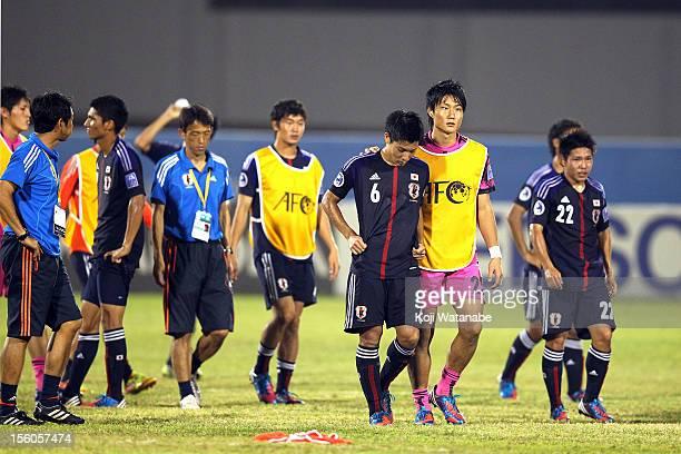 Ryosuke Yamanaka and Shota Ikemura of Japan looks dejected during the AFC U19 Championship quarter final match between Iraq and Japan at Emirates...