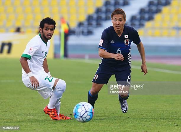 Ryosuke Yamanaka of Japan takes on Abdulrahman Fahad M Bin Khayrallah of Saudi Arabia during the AFC U-23 Championship Group B match between Saudi...