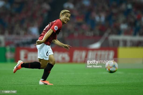 Ryosuke Yamanaka of Urawa Red Diamonds competes for the ball during the AFC Champions League round of 16 first leg match between Urawa Red Diamonds...
