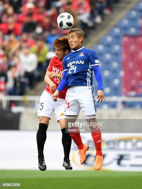 Ryosuke Yamanaka of Yokohama FMarinos and Kazuki Nagasawa of Urawa Red Diamonds compete for the ball during the JLeague J1 match between Urawa Red...