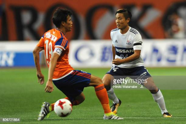 Ryosuke Yamanaka of Yokohama FMarinos and Kisho Yano of Albirex Niigata compete for the ball during the JLeague J1 match between Albirex Niigata and...
