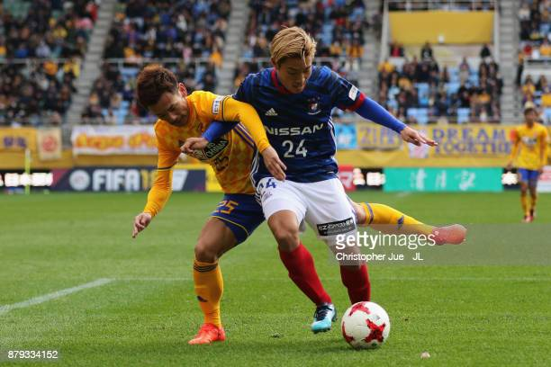 Ryosuke Yamanaka of Yokohama F.Marinos and Naoki Sugai of Vegalta Sendai compete for the ball during the J.League J1 match between Vegalta Sendai and...