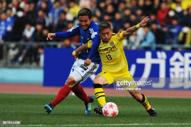 Ryosuke Yamanaka of Yokohama FMarinos and Ryuta Koike of Kashiwa Reysol compete for the ball during the 97th Emperor's Cup semi final match between...