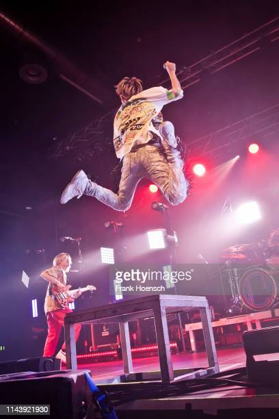 Ryota and Taka of the Japanese band One Ok Rock perform live on stage during a concert at the Huxleys on May 14 2019 in Berlin Germany