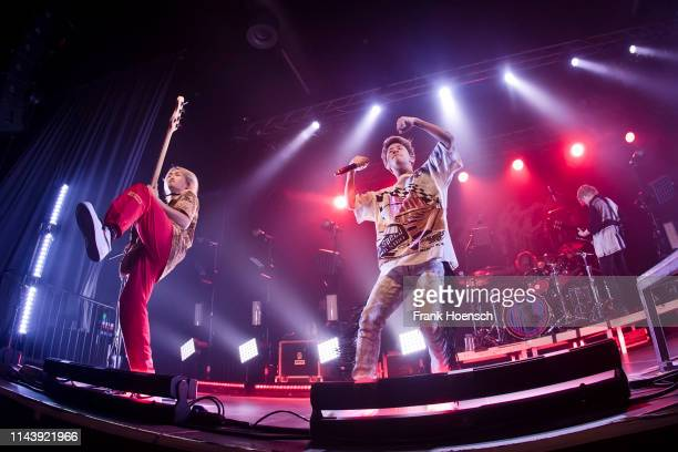Ryota and Taka of the Japanese band One Ok Rock perform live on stage during a concert at the Huxleys on May 14, 2019 in Berlin, Germany.