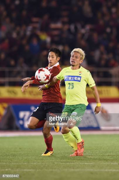 Ryota Aoki of Nagoya Grampus and Yusuke Higa of JEF United Chiba compete for the ball during the JLeague J1 Promotion PlayOff semi final match...