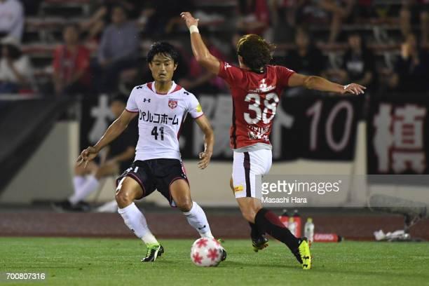 Ryota Iwabuchi of Gurlla Morioka and Daisuke Kikuchi of Urawa Red Diamonds compete for the ball during the 97th Emperor's Cup second round match...