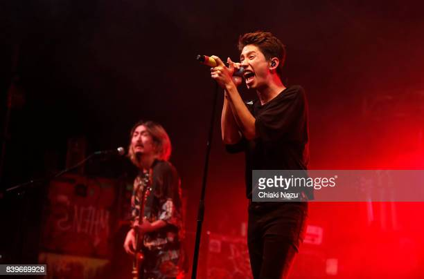 Ryota Kohama and Takahiro Moriuchi of One OK Rock perform at Reading Festival at Richfield Avenue on August 26 2017 in Reading England