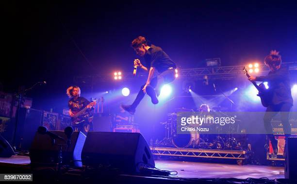 Ryota Kohama Takahiro Moriuchi Tomoya Kanki and Toru Yamashita of One OK Rock perform at Reading Festival at Richfield Avenue on August 26 2017 in...