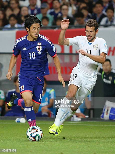 Ryota Morioka of Japan in action during the KIRIN CHALLENGE CUP 2014 international friendly match between Japan and Uruguay at Sapporo Dome on...