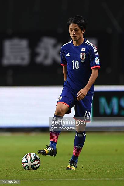 Ryota Morioka of Japan keeps the ball during the Kirin Challenge Cup 2014 international friendly match between Japan and Uruguay at Sapporo Dome on...