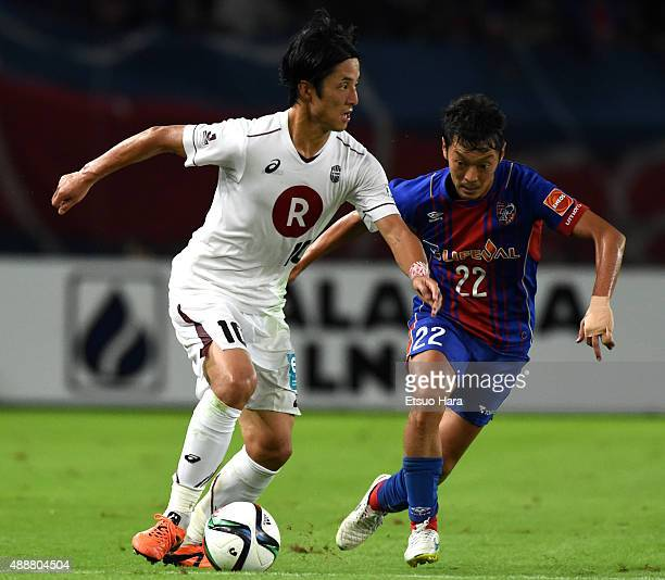 Ryota Morioka of Vissel Kobe and Naotake Hanyu of FC Tokyo compete for the ball during the JLeague match between FC Tokyo and Vissel Kobe at...