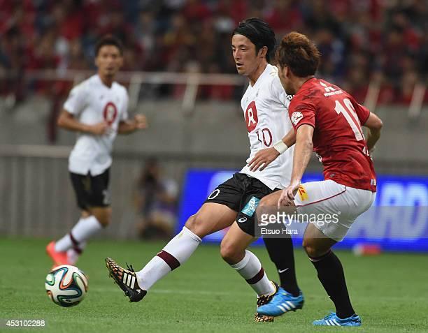 Ryota Morioka of Vissel Kobe and Takuya Aoki of Urawa Red Diamonds compete for the ball during the J League match between Urawa Red Diamonds and...