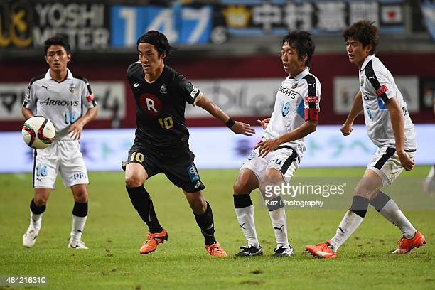 Ryota Morioka of Vissel Kobe keeps the ball under the pressure from Kengo Nakamura Shogo Taniguchi and Ryota Oshima of Kawasaki Frontale during the...