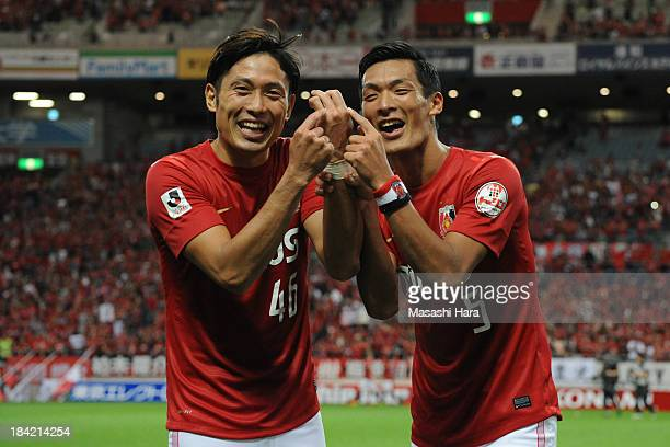 Ryota Moriwaki and Tomoaki Makino of Urawa Red Diamonds point to the ring finger of the left hand of Moriwaki who got married on October 10 after the...