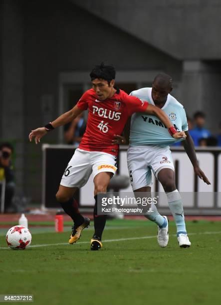Ryota Moriwaki of Urawa Red Diamonds and Adailton of Jubilo Iwata compete for the ball during the JLeague J1 match between Jubilo Iwata and Urawa Red...