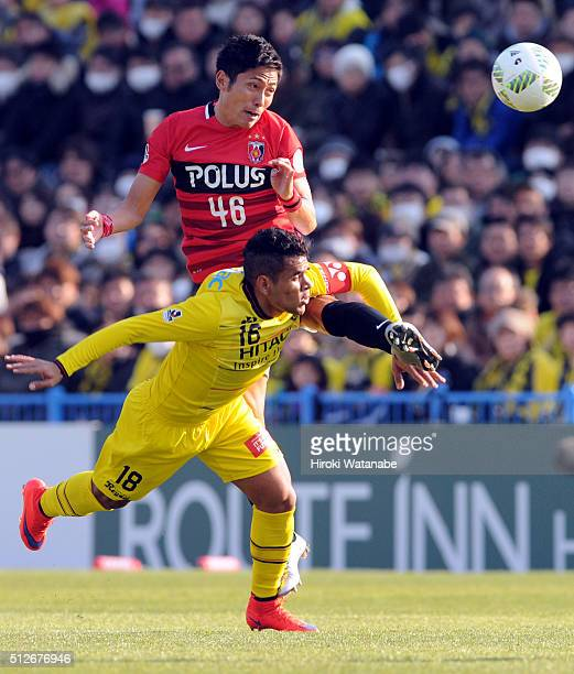 Ryota Moriwaki of Urawa Red Diamonds and Ederson of Kashiwa Reysol compete for the ball during the JLeague 2016 match between Kashiwa Reysol and...