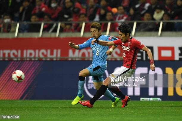 Ryota Moriwaki of Urawa Red Diamonds and Hiroyuki Abe of Kawasaki Frontale compete for the ball during the JLeague J1 match between Urawa Red...