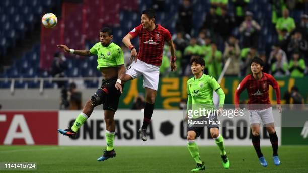 Ryota Moriwaki of Urawa Red Diamonds and Ricardo Lopes of Jeonbuk Hyundai Motors compete for the ball during the AFC Champions League Group G match...