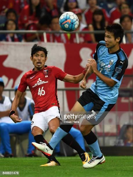 Ryota Moriwaki of Urawa Red Diamonds and Shintaro Kurumaya of Kawasaki Frontale compete for the ball during the AFC Champions League quarter final...
