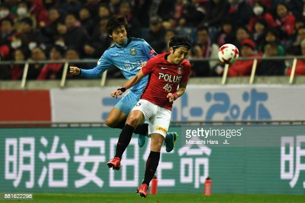 Ryota Moriwaki of Urawa Red Diamonds and Shintaro Kurumaya of Kawasaki Frontale compete for the ball during the JLeague J1 match between Urawa Red...