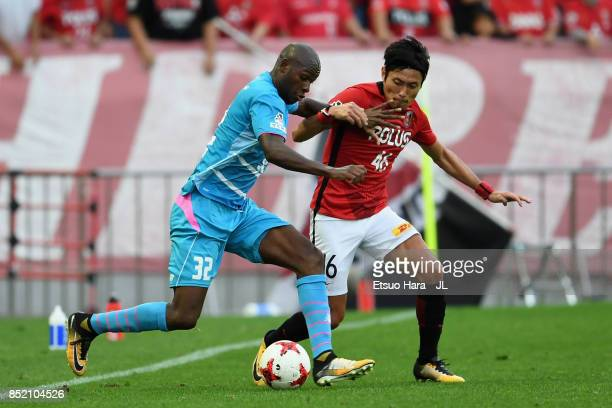 Ryota Moriwaki of Urawa Red Diamonds and Victor Ibarbo of Sagan Tosu compete for the ball during the JLeague J1 match between Urawa Red Diamonds and...