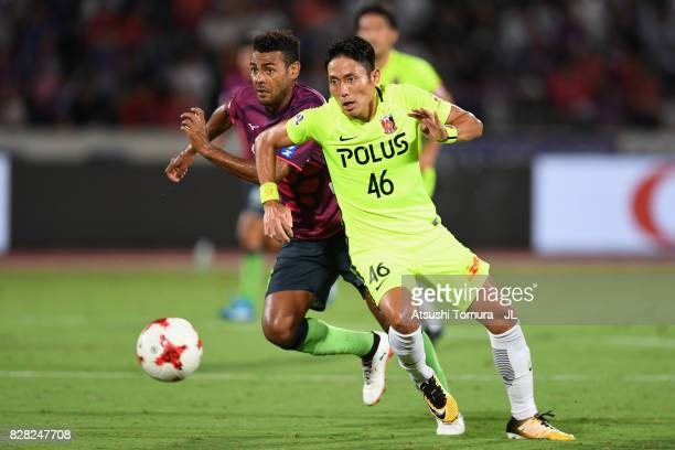 Ryota Moriwaki of Urawa Red Diamonds and Wilson of Ventforet Kofu compete for the ball during the JLeague J1 match between Ventforet Kofu and Urawa...