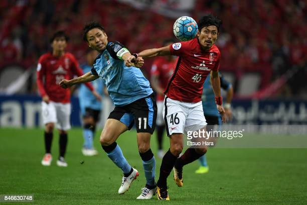 Ryota Moriwaki of Urawa Red Diamonds and Yu Kabayashi of Kawasaki Frontale compete for the ball during the AFC Champions League quarter final second...