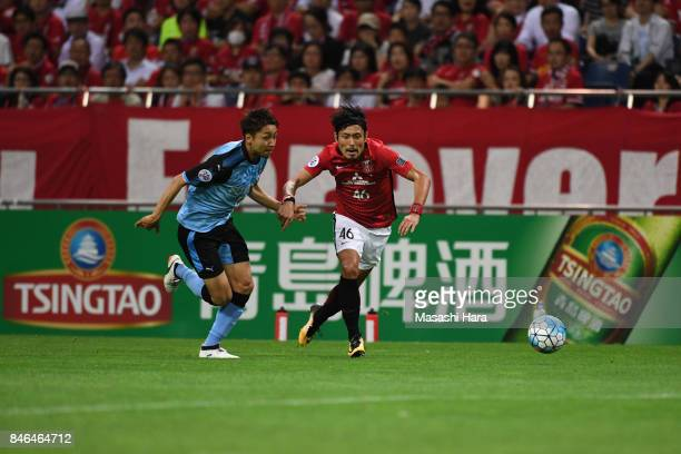 Ryota Moriwaki of Urawa Red Diamonds and Yu Kobayashi of Kawasaki Frontale compete for the ball during the AFC Champions League quarter final second...